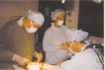 Dr. Brantigan and staff at work.